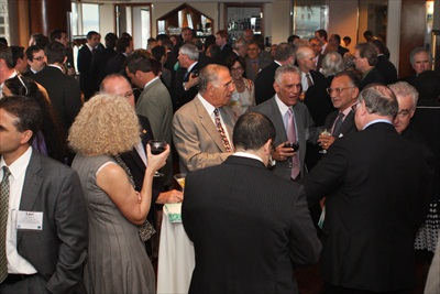 Attendees network before the program begins