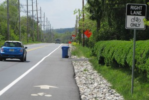 After: The new design of County Road 518 includes a bicycle lane and stormwater management elements; Photo Credit: Parsons Brinckerhoff