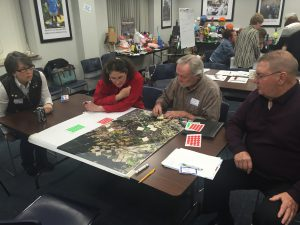 Attendees from the Pinelands workshop look at a local map and discuss problem spots or barriers, and identify places where green infrastructure opportunities could be explored.