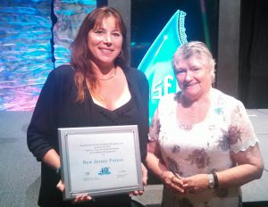 Maria DiSalvatore, left, vice chairwoman of the New Jersey Association for Floodplain Management, accepting New Jersey Future's award at the Association for Floodplain Management national conference in Grand Rapids, Michigan.