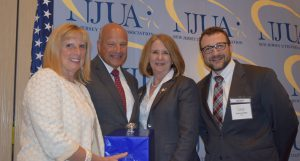 Photo: (left to right) The Hon. Mary-Anna Holden, commissioner, NJ Board of Public Utilities; Robert Iacullo, NJUA's 2016 Distinguished Service Award recipient; Mary Patricia Keefe, chairperson, NJUA and vice president, regulatory affairs and business support, Elizabethtown Gas; Andrew Hendry, president and CEO, NJUA.