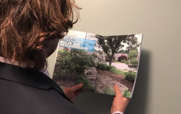 Person reading the New Jersey Developers Green Infrastructure Guide 2.0